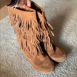 Tall brown fringe boots